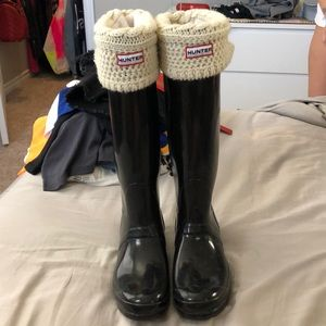 black tall hunter boots